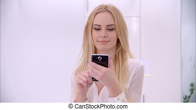 Young Blond Girl Using Mobile Phone - Young Sexy Blond Girl...