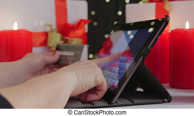 Christmas gifts shopping in online store - Woman with credit...