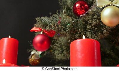 Dolly: Burning candles under Christmas tree background