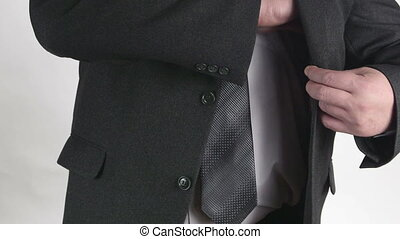 Business person pulling out his wallet from pocket