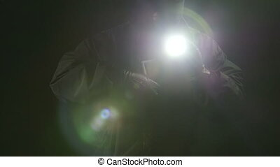 Thief stealing stacks of dollars at night