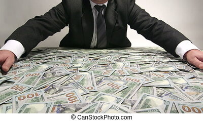 Greedy business person grabbing lot of hundred dollar bills