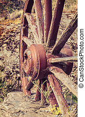 The old wooden wagon wheel  at a farm