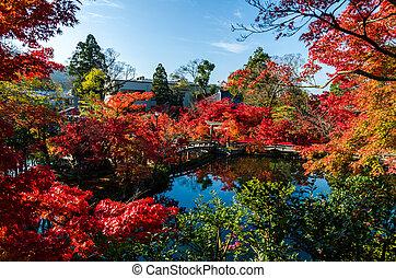Autumn foliage at the stone bridge in Eikando Temple, Kyoto,...