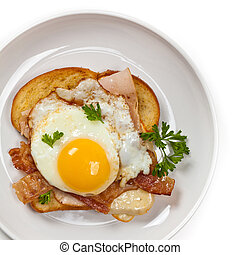 Toasted Sandwich with fried eggs - Traditional French...