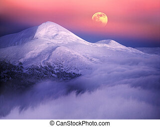 Moonrise among alpine peaks, unforgettable beauty of the...