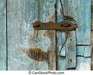 Wooden door of old barn, isolated on background