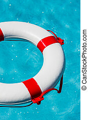 lifebuoy in a pool - an emergency tire floating in a pool....