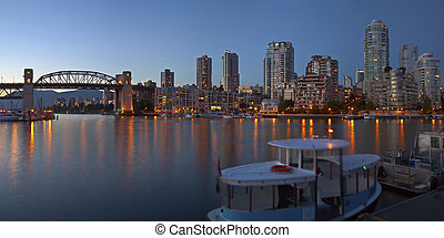 Vancouver BC skyline at False Creek at dusk - Vancouver BC...
