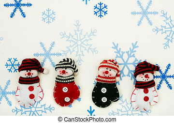 Happy Holidays - Four snowman mittens sitting together on a...