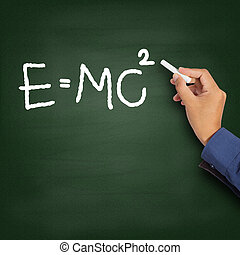 Hand writing theory of relativity E=mc2 on a chalkboard