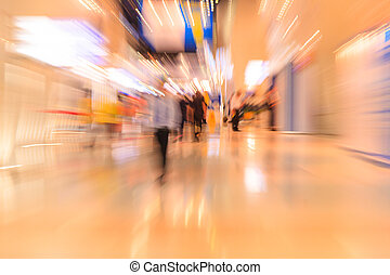 People in the lobby. motion blur - People rushing in the...
