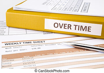 Working overtime - Overtime words on document binder place...
