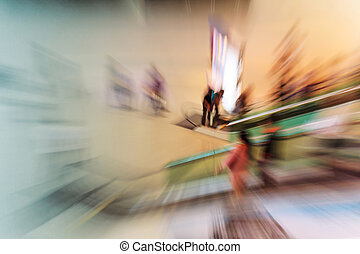 People in escalators at the modern shopping mall. motion...