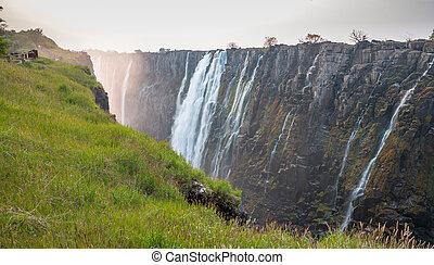 Victoria Falls sunset, Zambia side with zambezi river -...