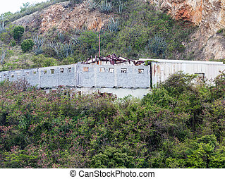 Old Building on Tropical Hillside with Hurricane Damage