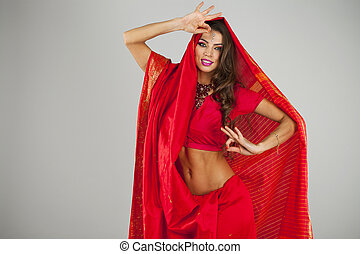 Young pretty woman in indian red dress - Young beautiful...
