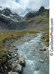 Gill in valley nearby glacier in Alps in Switzerland - Gill...