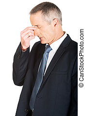 Portrait of businessman suffering from sinus pain