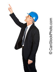 Side view of businessman engineer pointing up
