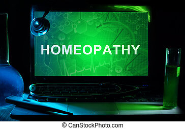 homeopathy - Notebook with words homeopathy, test tubes and...