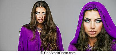 Two young sexy women in purple tunic Arabic - Beautiful...