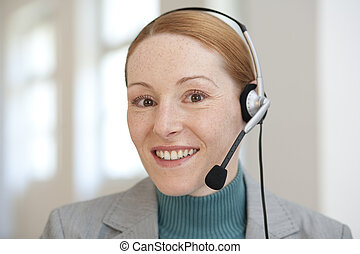 Woman with red hair and headphone
