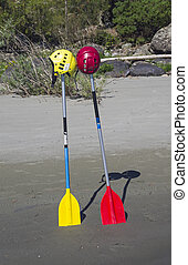 Two oars, stuck in the sand.