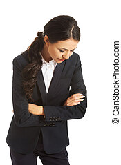 Businesswoman with folded arms looking down