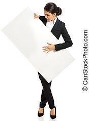 Full length businesswoman holding white banner