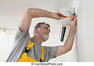 Electrical installation of air conditioner, electrician at...