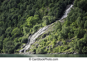 Waterfall in the Geirangerfjord in Norway.