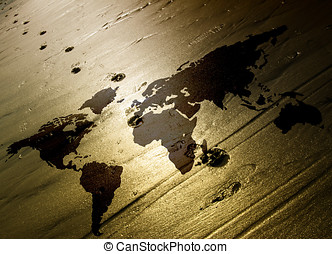 World traveller - Lone footprints walk across world map in...