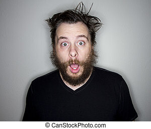 bearded man looking at the camera shocked - He is surprised...