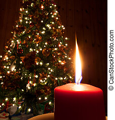 Tall flame - Flame coming from a red candle in front of a...