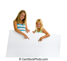 sister girls with white board - sister girls holding a white...