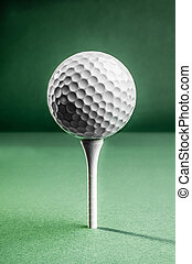 Golf Ball on Tee - A white golf ball positioned on top of a...