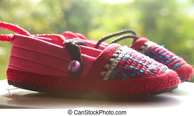 knitted baby shoes with embroidered national with ties...