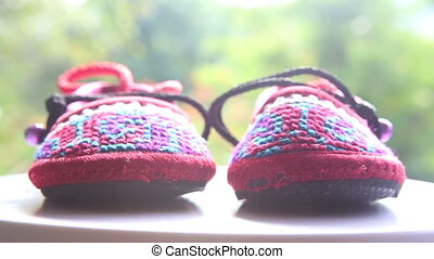 knitted baby shoes with embroidered national with ties on...