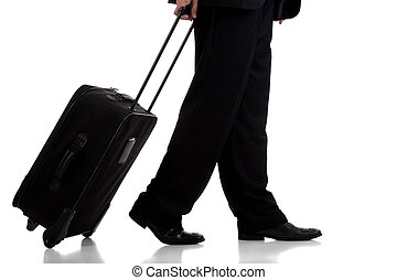 Business traveler or pilot with suitcase - A business...