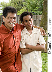 Father and teenage son - Hispanic father and African...