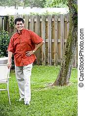 Hispanic man in backyard
