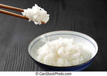 Japanese steamed rice - close up shot of typical Japanese...
