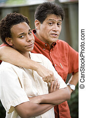Father and son - African American teenage boy with Hispanic...