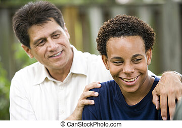 Father and teenage son - Hispanic father with African...