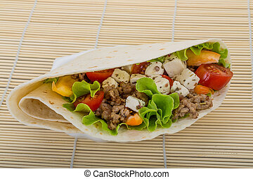 Pork tortilla with salad, tomato and soft cheese