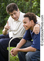 Father and teenage son - Interracial Hispanic father and...