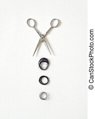 Hair asian cut off scissors on white wall background
