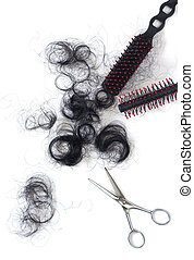 hair asian cut off scissors and comb on white background