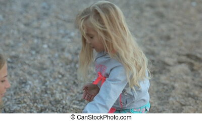 Little girl with her parents near the sea